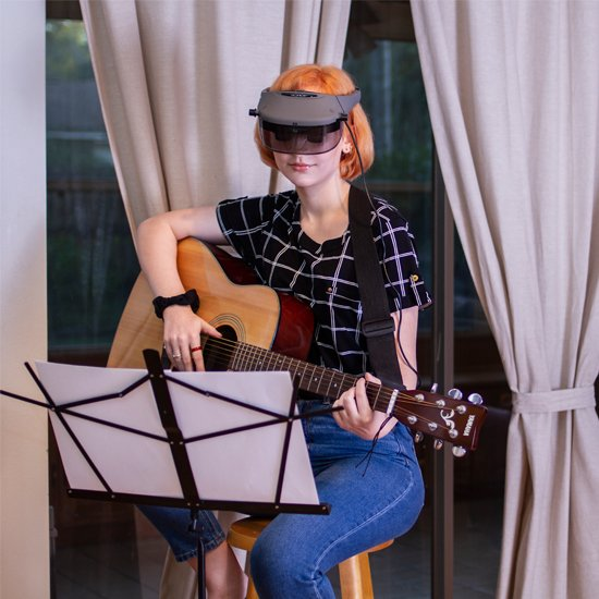 Acesight enables you to free your hands to do what you want, like playing guitar.